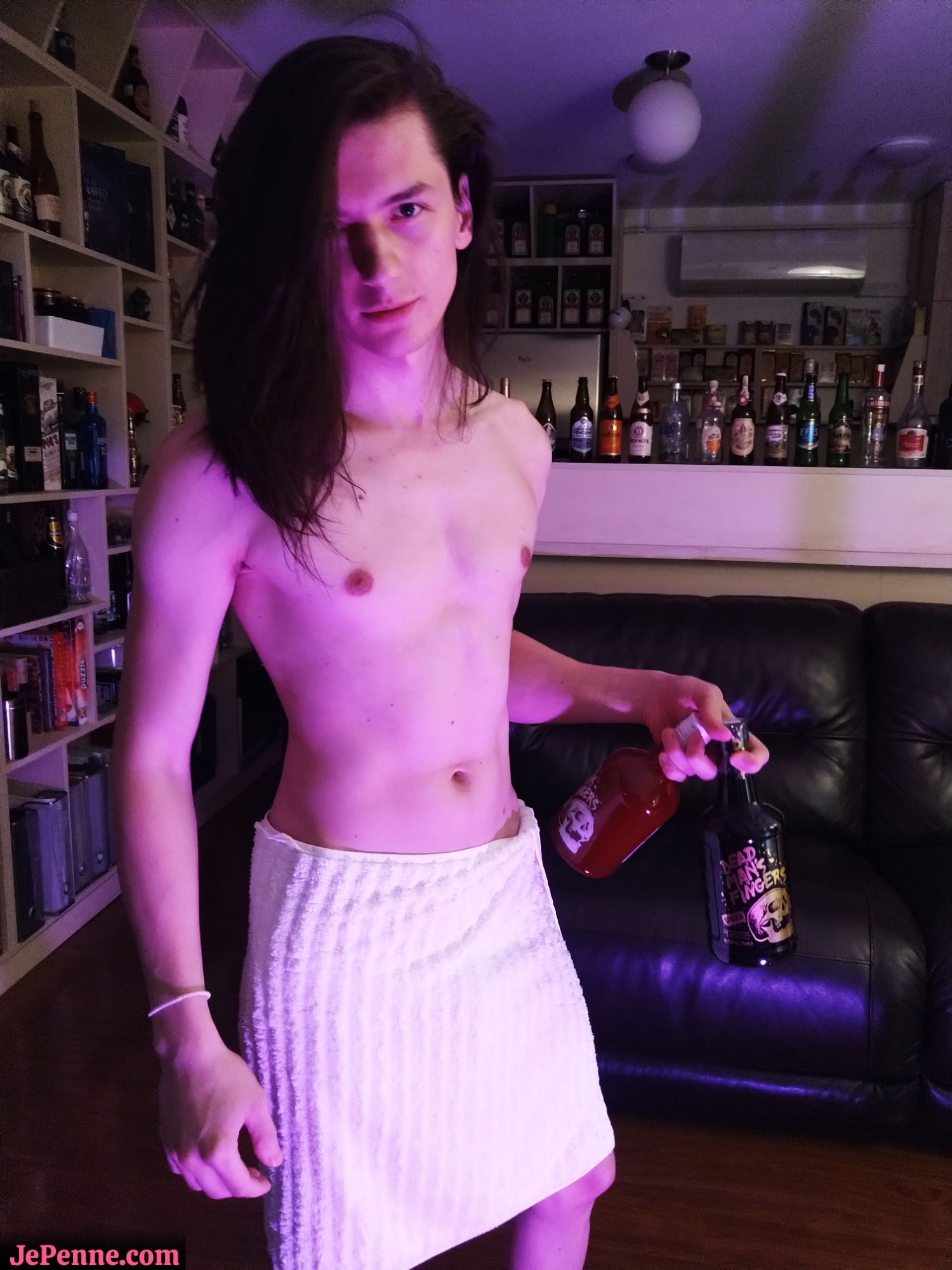 JePenne (slim, fit, long dark hair) with only a towel to hide his manly parts is holding 2 drinks.